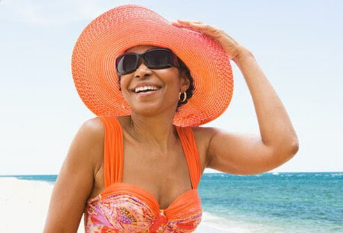 Photo of woman with sun hat.