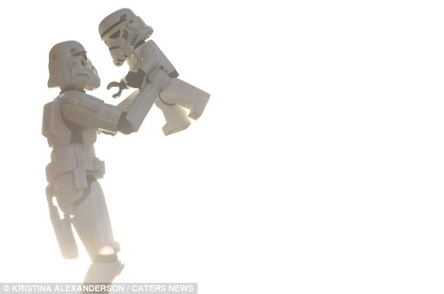 Tender trooper: Darth Vader's enforcer holds his young boy in a loving embrace. Artist Kristina Alexanderson has created more than 500 images of the pair