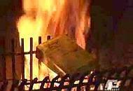 Il libro del Concilio dato alle fiamme (foto Antenna Tre)
