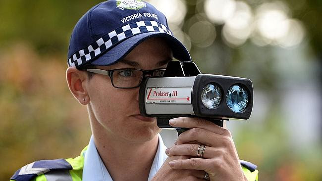 An officer targetting speeding drivers.