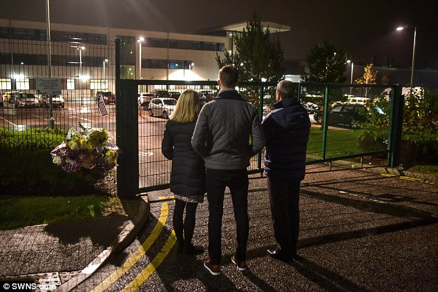 Mourners at the gates of Cults Academy tonight after a teenager was stabbed at the school