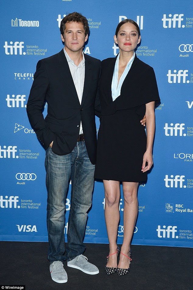 'Blissfully happy': Cotillard r is in a relationship with fellow actor Guillaume Canet, 43, and they have one child together (Guillaume directed Marion in his first American film, Blood Ties, they are seen here at the premiere in 2013)