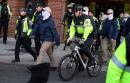 Masked white nationalists march in Washington with police escort