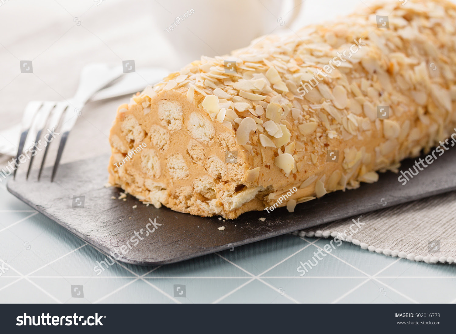 http://www.shutterstock.com/pic-502016773/stock-photo-original-recipe-napoleon-cake-roll-decorated-with-almond-flakes-shallow-focus.html?