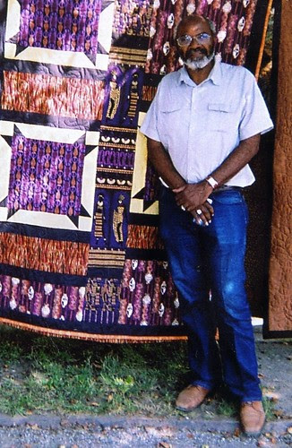 Abayomi Azikiwe, editor of the Pan-African News Wire, standing next to a quilt at the Detroit Bead Museum on the city's west side in September 2008. (Photo: Omorose) by Pan-African News Wire File Photos