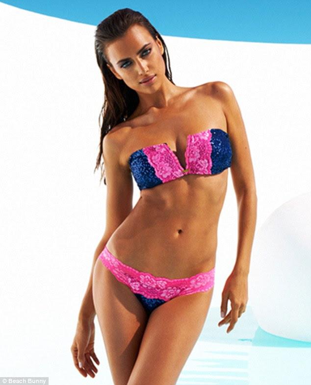 Beach babe: Irina Shayk shows off her enviably perfect body as she shoots Beach Bunny's latest swimwear range