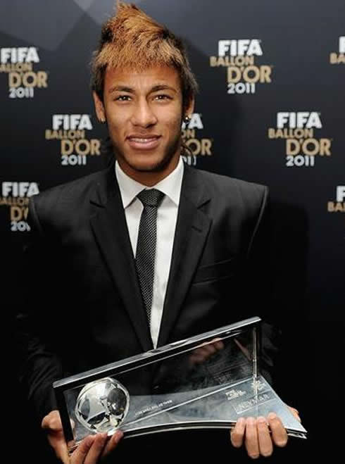Neymar showing his Puskas Goal of the Year trophy, won at the FIFA Balon d'Or 2011-2012 gala and ceremony