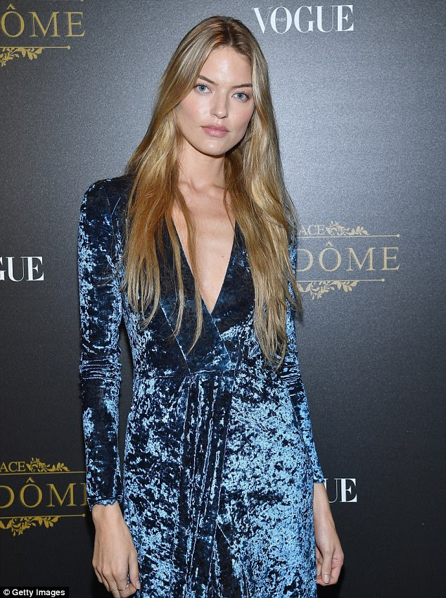 Feeling blue: Fellow model Martha Hunt oozed glamour in a blue crushed velvet wrap dress