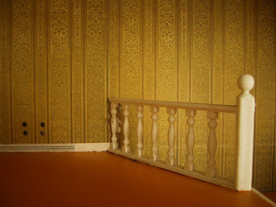 White plastic rails at the top of the stairs in a vintage Lundby dolls' house.