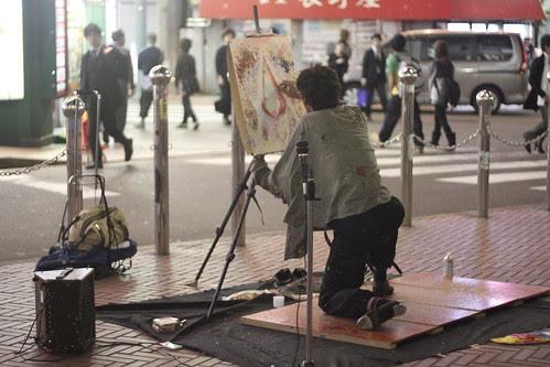 Tap dancing painter Denis paints