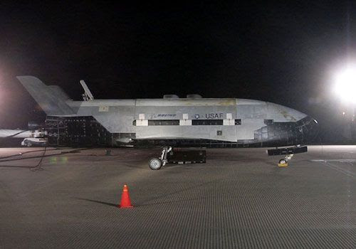 The X-37B Orbital Test Vehicle (OTV) on a runway at Vandenberg Air Force Base, California...after returning home from space on December 3, 2010.
