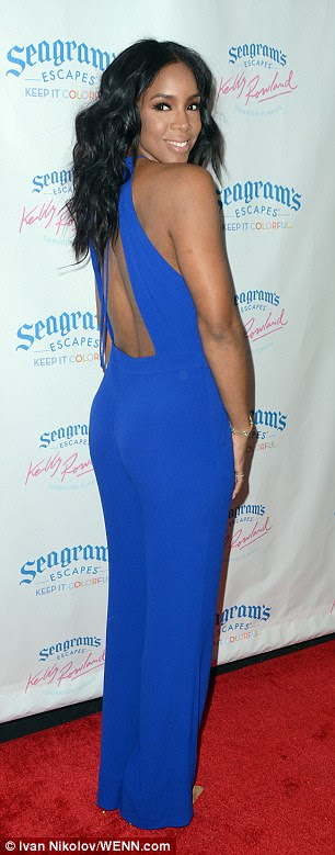 Looking good: The 34-year-old songstress gave a twirl to show off the back of her elegant outfit