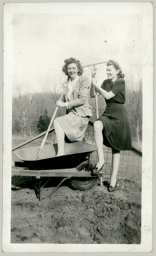 Two women and a Wheel Barrow