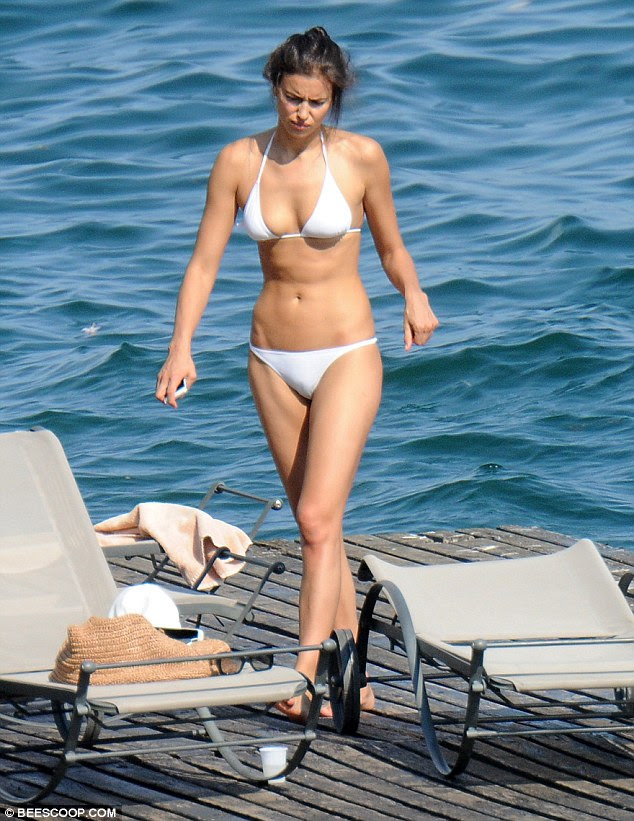 Stripped down: The Russian beauty confidently paraded her endless legs in a skimpy white bikini