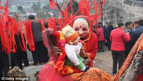 Fun for all: Locals took their young children and babies out for the traditional day too