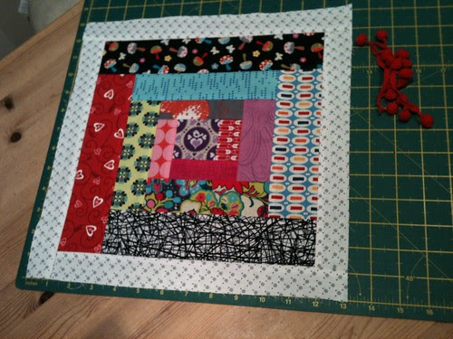 Rainbow Scrappy Log Cabin block with a border