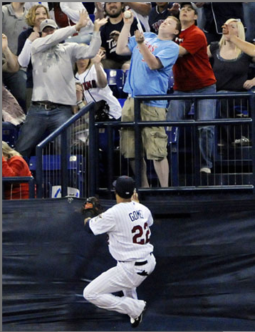 (Jim Mone/AP) Great hand(s) by the fan in blue while Nick Lachey shields his eyes