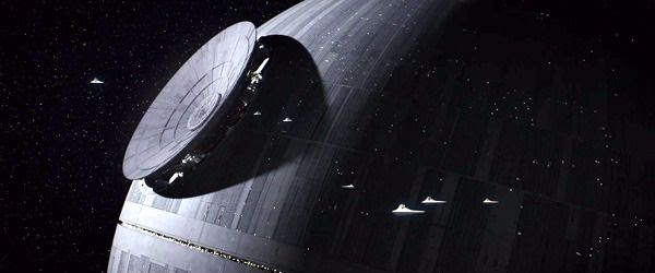 Several Imperial Star Destroyers patrol the area as the dish for the Death Star's superlaser cannon is about to be installed in ROGUE ONE: A STAR WARS STORY.