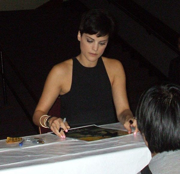 Jaimie Alexander, from THOR and AGENTS OF S.H.I.E.L.D., does an autograph signing at the Los Angeles Shrine Auditorium, on March 16, 2014.