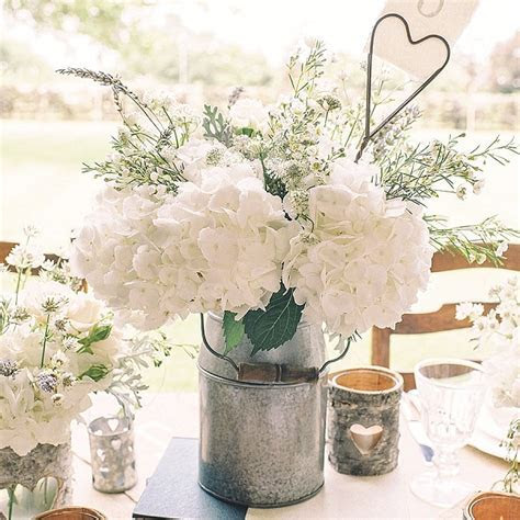 10 Rustic Wedding Centrepieces   Tree Slices & Bark Vases