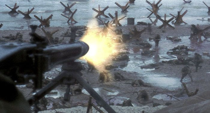 A German gunner (out of frame) fires away at Allied soldiers who land on a beach at Normandy in SAVING PRIVATE RYAN.
