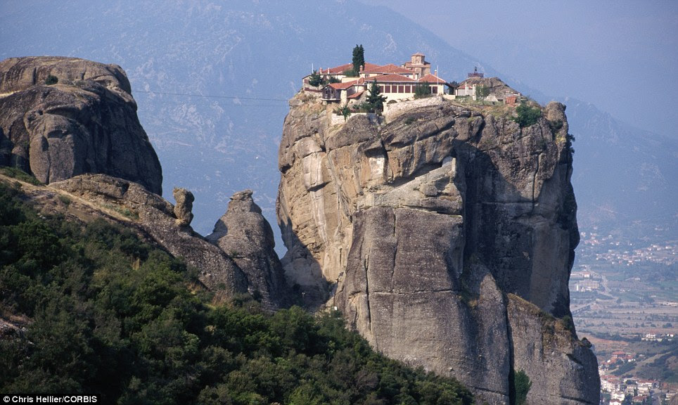 Between a rock and a hard place: The Holy Trinity is part of the Meteora - which translates as 'suspended in the air' - complex of monasteries in Greece, one of the largest collections of such buildings in the country