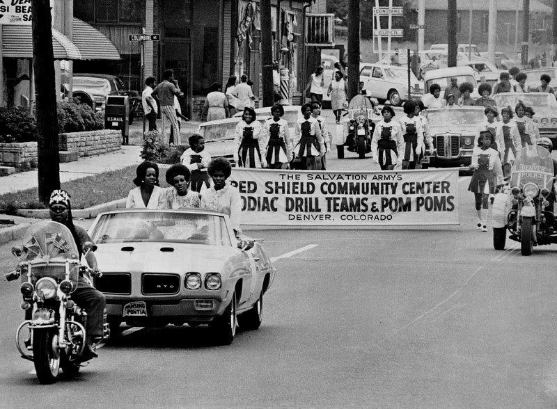 Description of  JUL 18 1970 - Three Miss Black Colorado candidates are Gloria Lott, Left, Brenda Humburd and Brenda Johnson. Following the convertible is Salvation Army's Red Shield Community Center Zodiac drill teams and pompom girls. (Bill Wunsch/The Denver Post)