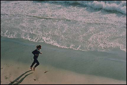2nd view of figure running on beach