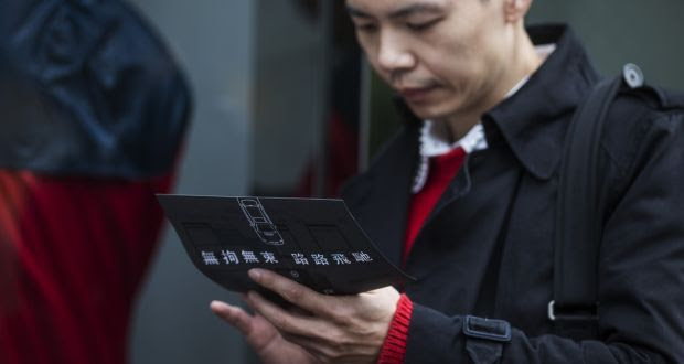 An  Uber Technologies  driver recruitment event in Hong Kong. Photograph: Justin Chin/Bloomberg