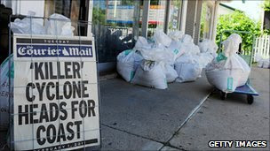 Sandbags and a news board outside a shop in Townsville, Queensland, on 1 Feb 2011