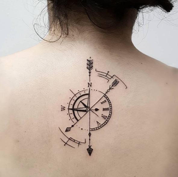 Compass With Arrow Tattoo On Girls Back