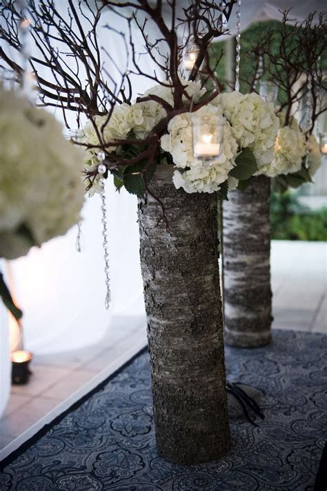 Wedding  lace wrapped vase with flowers, branches with