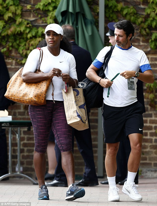 Williams (left) is seen near the practice courts with coach Patrick Mouratoglou at Wimbledon on Sunday