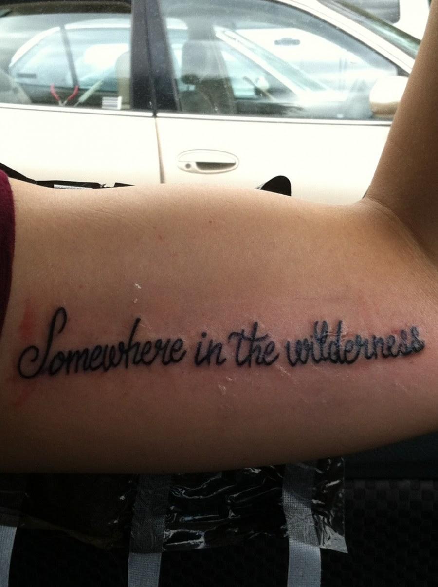 Lettering Inner Bicep Tattoo Design Tattoomagz