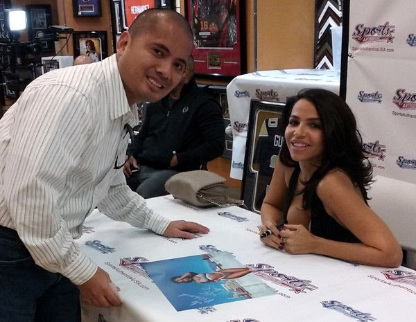 Posing with Vida Guerra inside Sports Authentics USA at Puente Hills Mall...on January 21, 2017.