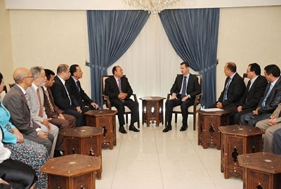 Syrian President Bashar al-Assad meeting with Tunisian parties on May 24, 2013. The president stressed the need for Pan-Arabist parties to combat reactionary ideology. by Pan-African News Wire File Photos