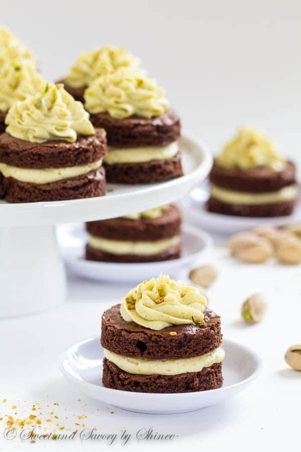 Fudgy, yet light chocolate cake layers, filled with fluffy pistachio buttercream and cut into adorable mini cakes, are irresistible crowd-pleaser.