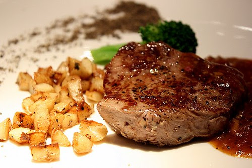 Tenderloin steak (120g), served with cubed grilled garlic and a lonely sprig of broccoli