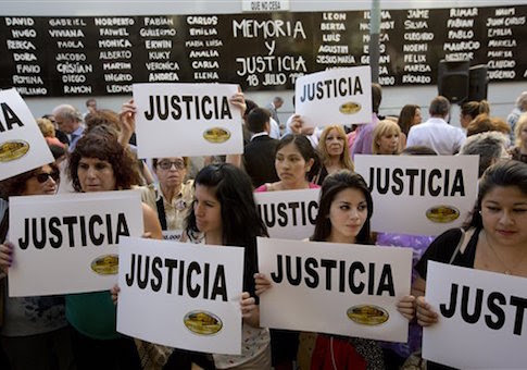 """People gather outside the AMIA Jewish community center asking for """"Justice"""" in the death of a prosecutor who had accused Argentinaís president of a criminal conspiracy, in Buenos Aires, Argentina, Wednesday, Jan. 21"""