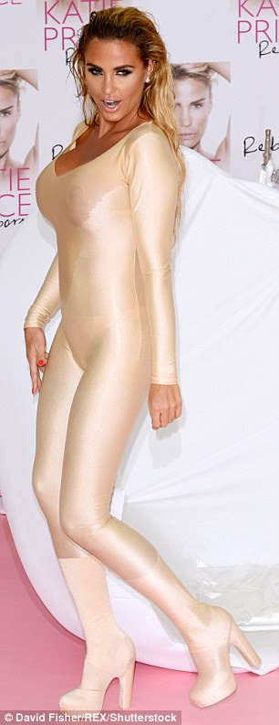 Golden girl: She showed off her svelte frame in a golden catsuit, teamed with matching boots