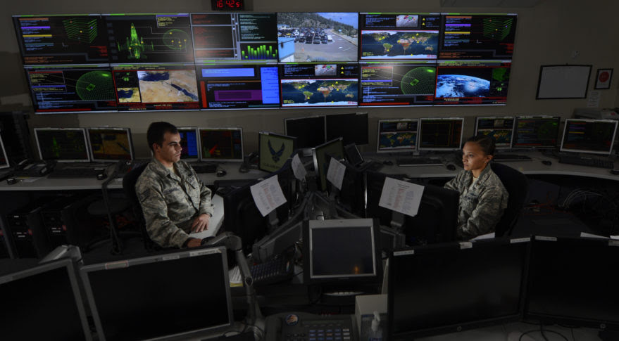 Airmen at the Global Strategic Warning and Space Surveillance System Center at Cheyenne Mountain, Colorado, monitor strategic missile warning systems. (Air Force photo)