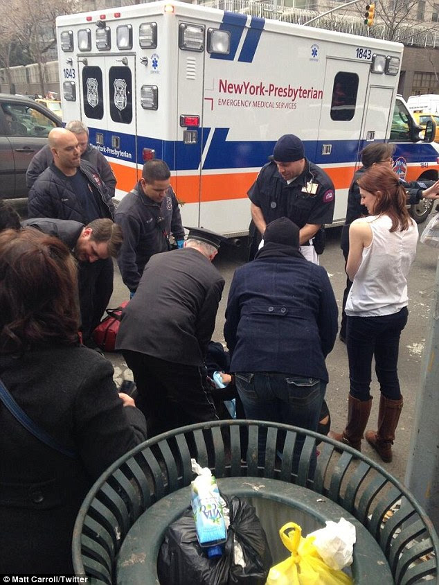 Quick labor: A woman gave birth to a baby girl on a New York City crosswalk yesterday afternoon