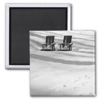 Two Chairs Buried In Snow