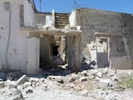 A handout picture released by Shaam News Network shows the alleged destruction by Syrian government forces in the city of Qusayr. (AFP Photo/)