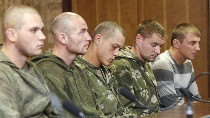 A group of Russian servicemen, who are detained by Ukrainian authorities, attend a news conference in Kiev August 27, 2014. (Reuters/Valentyn Ogirenko)
