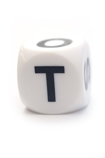 Character T on the dice: Letter on the cube