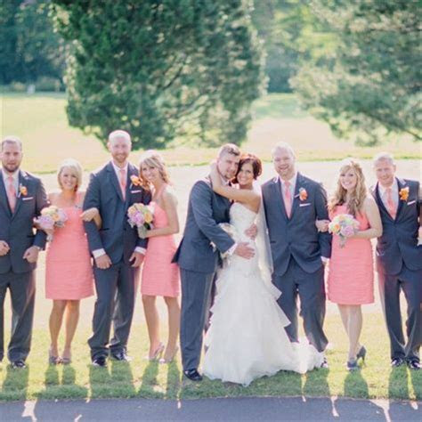 Girls in coral dresses, and guys in gray suits with coral