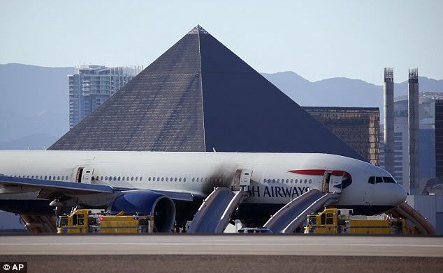 Casinos along the Las Vegas Strip can be seen behind the aircraft that suffered a massive engine failure