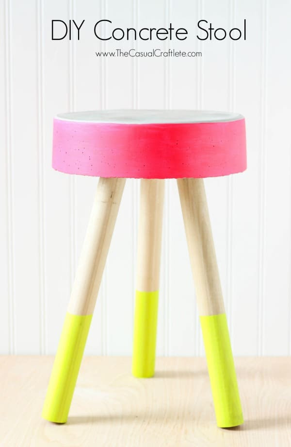 DIY Concrete Stool - easy to make bucket concrete stool for just $5. Add fun bright patio paint for pops of fresh modern color. Perfect for an outdoor stool or plant stand.