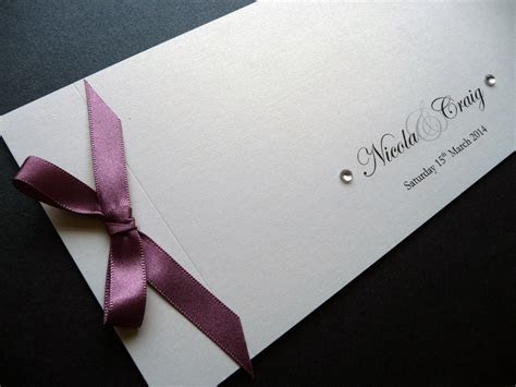 Cheque Book Wedding Invitation with a Dusky Pink Ribbon